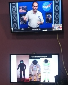 Terry Hill holding lectures. Underneath suits that may be used on Mars.