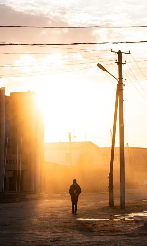 Boy walking home in Khiva